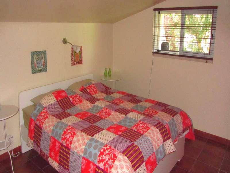 Vakantiehuis op kleinschalig vakantie park met zwembad - Casa Palmeira master bedroom